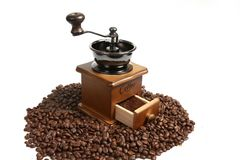 Vintage manual coffee grinder with coffee beans. Isolated antique coffee grinder and coffee beans Royalty Free Stock Photo