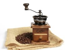 Vintage manual coffee grinder with coffee beans. Isolated antique coffee grinder and coffee beans Royalty Free Stock Images