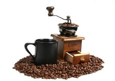 Vintage manual coffee grinder with coffee beans. Isolated antique coffee grinder and coffee beans Stock Photos