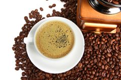 Hot coffee, Vintage manual coffee grinder with coffee beans on wooden spoon Stock Photography