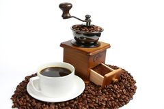 Hot coffee, Vintage manual coffee grinder with coffee beans on wooden spoon Stock Photo
