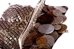 Purse with coins. Isolated antique purse with lots of old coins Royalty Free Stock Photography