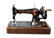 Isolated antique sewing machine. On white Stock Photos