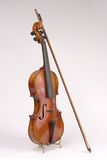 Isolated Antique Violin & Bow. Isolated View of Antique Violin & Bow on Stand Stock Image