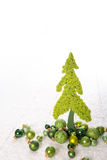 Isolated apple green christmas tree of felt decorated with balls Royalty Free Stock Photos