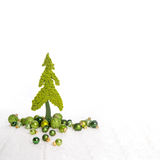 Isolated apple green christmas tree of felt decorated with balls Royalty Free Stock Images