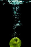 Isolated apple splashing Stock Photos