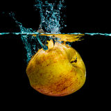 Isolated apple splashing Royalty Free Stock Photo