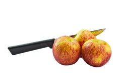 Isolated Apples. Photo of Stabbed Apples by knife on White Background Royalty Free Stock Images