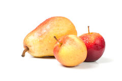 Isolated apples and pear with water drops Royalty Free Stock Photography