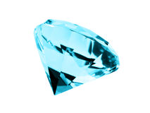 Isolated Aquamarine Jewel. A close up on a isolated Aquamarine jewel on a dark background. Shallow DOF Stock Photo