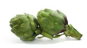 Isolated Artichokes. Two artichokes isolated on white Stock Photo