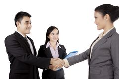 Isolated Asian business people handshake Stock Photos