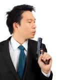 Asian male carry a gun on white Stock Photos
