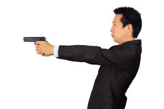Asian male shooting a gun on white Stock Image
