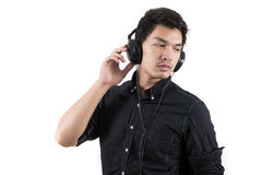 Isolated asian man with headset Royalty Free Stock Photos