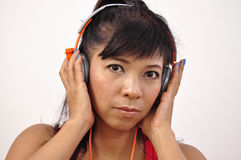 Isolated Asian woman with headphone Royalty Free Stock Image