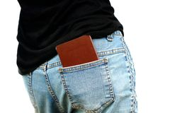 Isolated Asian woman put passport into back pocket of jeans stock photo