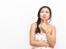 Isolated asian woman thinking about something Royalty Free Stock Photography