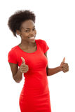 Isolated attractive african woman in red with thumbs up. Royalty Free Stock Photo