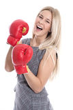 Isolated attractive blonde businesswoman ready to fight with box Royalty Free Stock Photography