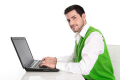 Isolated attractive businessman working with laptop on white. Stock Images