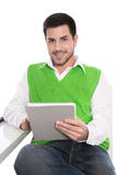 Isolated attractive smiling businessman with tablet pc. Royalty Free Stock Photos
