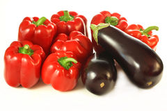 Isolated aubergines and paprikas Stock Photos