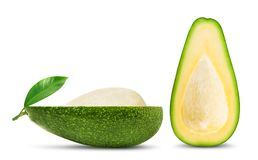 Half of avocado with leaf isolated. Isolated avocado. Two halves of fresh avocado fruit with seed and leaf isolated on white background royalty free stock photo