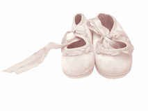 Isolated Baby Shoes. Isolated shot of baby shoes. With a bit of pink added royalty free stock images