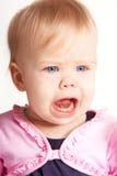 Isolated babygirl. Crying babygirl on white background Royalty Free Stock Images