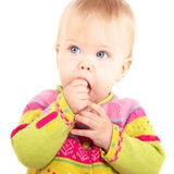 Isolated babygirl. Beautiful babygirl sucking hand on white background Stock Image