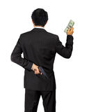 Back of an asian male carry a gun and money on white Stock Photo