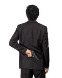Back of an asian male carry a gun on white Stock Photos
