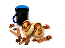 Isolated baked buns with blue cup Stock Images