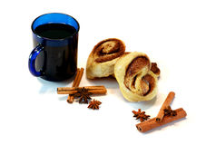 Isolated baked buns with blue cup Stock Photos