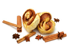 Isolated baked buns with cinnamon sticks Royalty Free Stock Photography