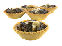 Isolated baked tartlets. Isolated baked tartlets with mushrooms and cheese Stock Images