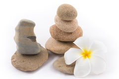 Isolated of the balance stones is zen for spa. The isolated of the balance stones with Frangipani flower is zen for spa on white background Royalty Free Stock Image