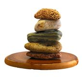 Isolated balancing pebbles Royalty Free Stock Photography