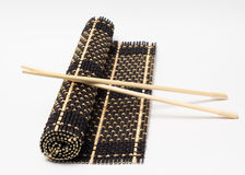 Isolated bamboo mat with chopsticks Stock Photography