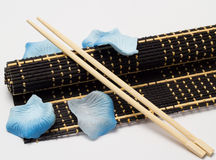 Isolated bamboo mat with chopsticks Stock Image
