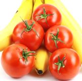 Isolated banana and tomatoes Stock Photos