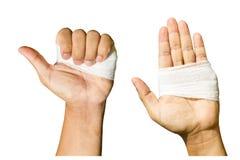 Isolated bandage hand on white Stock Images