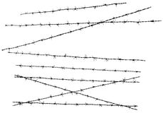 Isolated barbed wire. A photo of several isolated barbed wires. This is a black and white photo Royalty Free Stock Photos