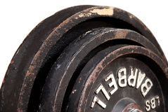 Isolated Barbells. Three-Quarters view of Three Different size rigid, aged barbells stacked against each other isolated on a white background Stock Photography