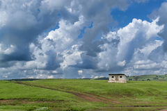 Isolated Barren Shed and Dark Rain Clouds Stock Photo