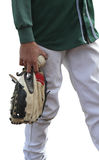 Isolated baseball player in green shirt. Isolated baseball player in a green shirt holding the ball and glove Royalty Free Stock Images