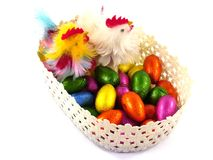 An isolated basket with Easter eggs and chickens Stock Photo