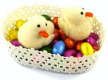 An isolated basket with Easter eggs and ducklings Royalty Free Stock Photo